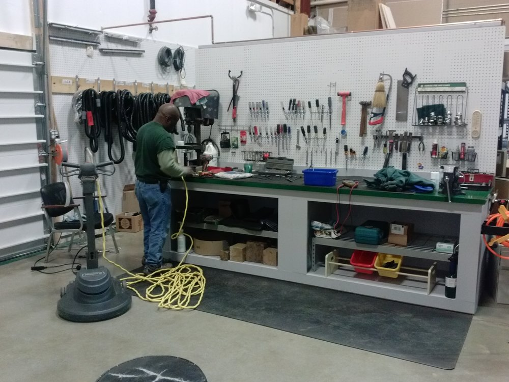 Work goes on at our small equipment bench, one of five operating repair stations in our expanded repair section.