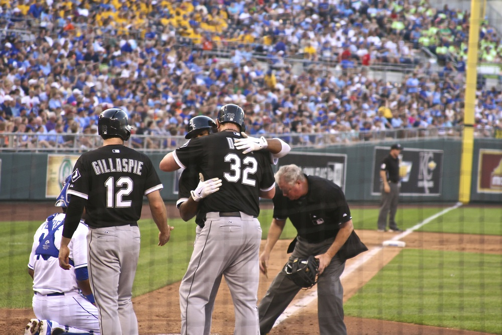 Dayan Viciedo embraces Adam Dunn after home run