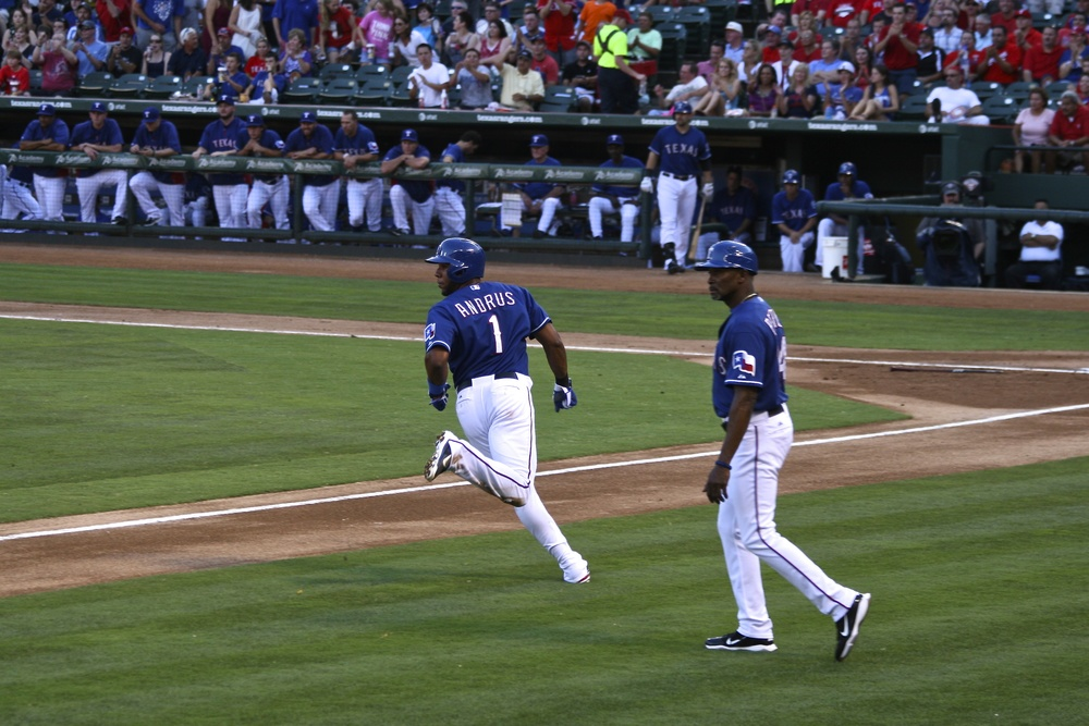 Elvis Andrus rounds third heading for home