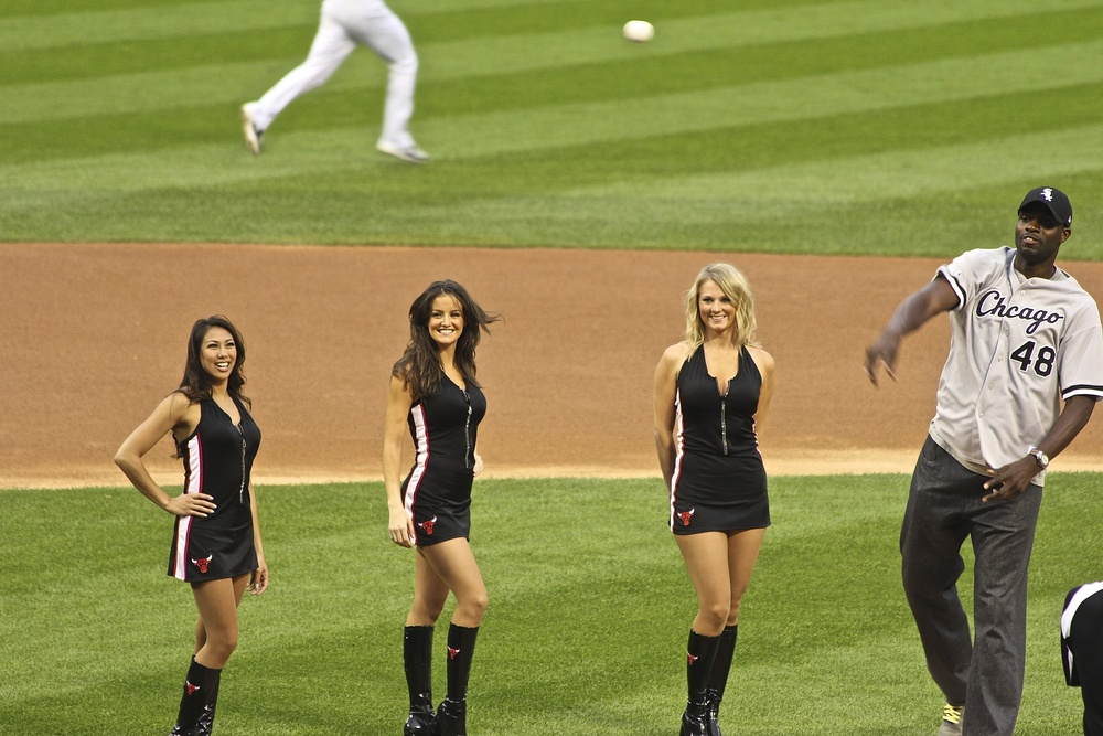 Chicago Bulls center Nazr Mohammed  tosses in the first pitch