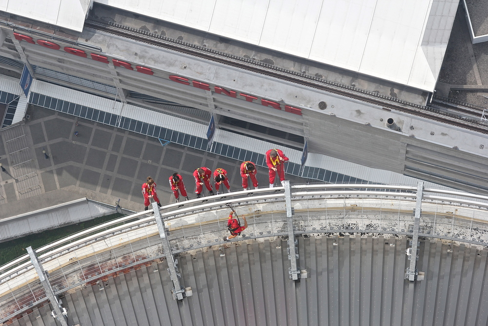 Some crazy people hanging off the CN Tower