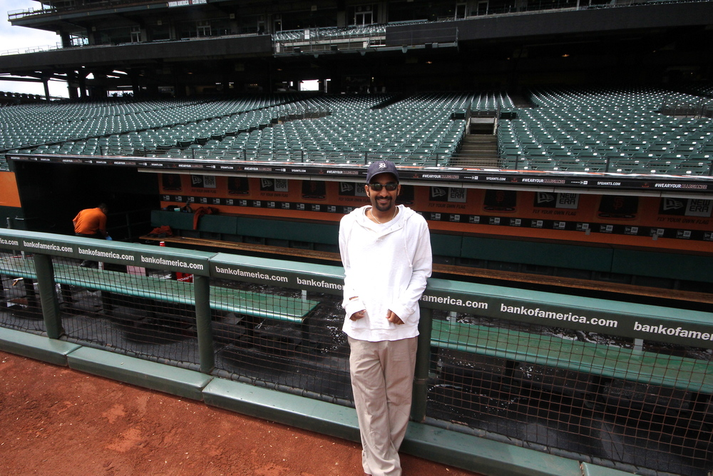 Me leaning on the dugout