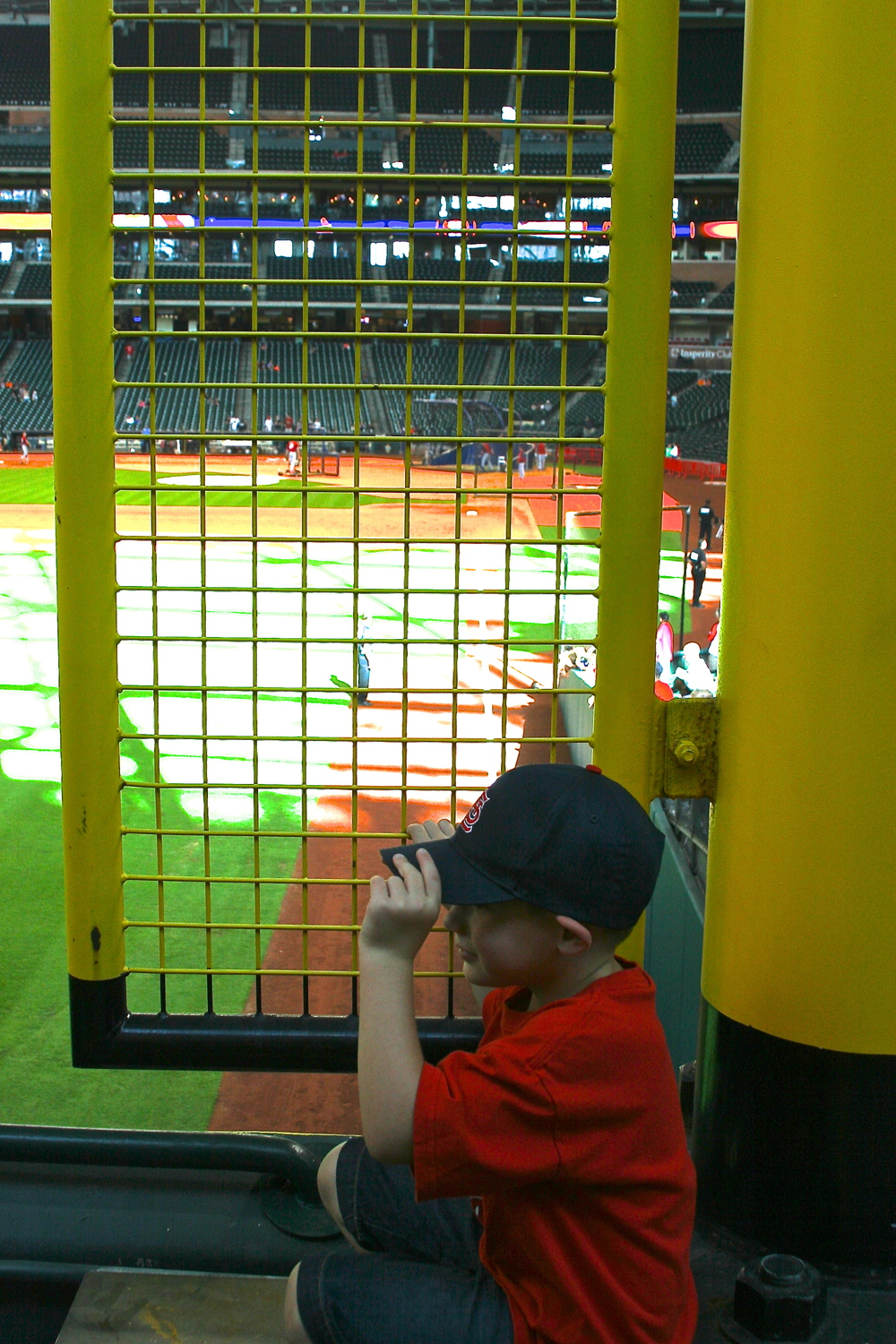 Kid hiding behind the foul pole
