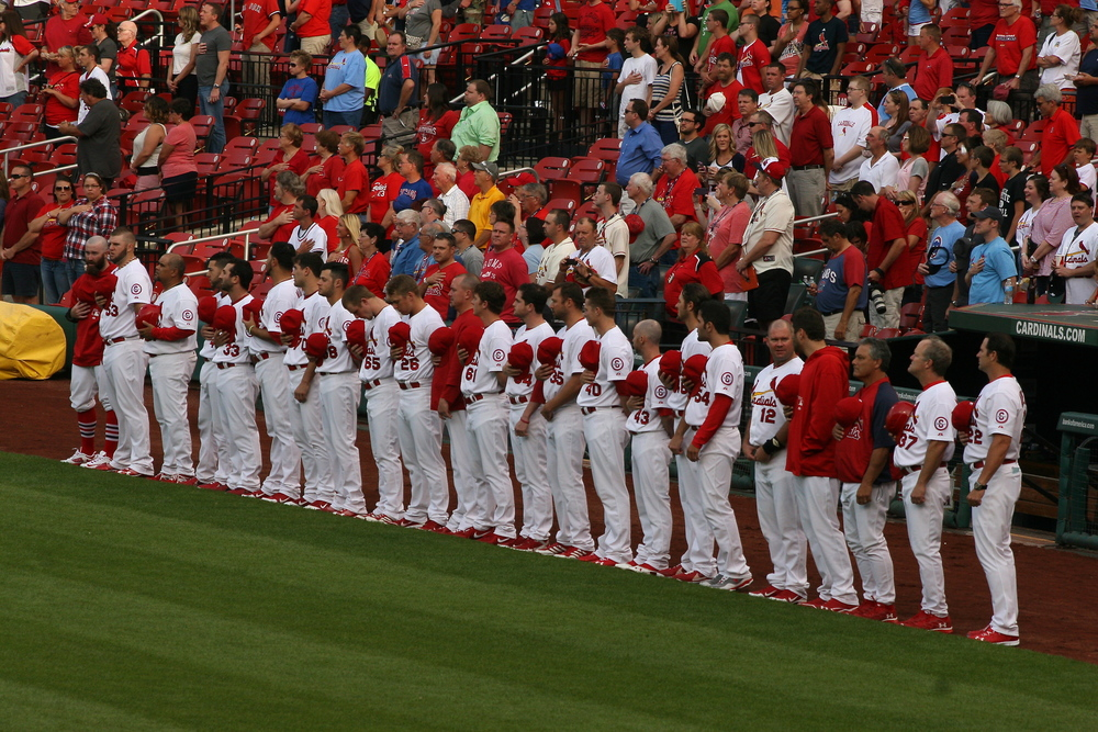 Cardinals standing for the National Anthem