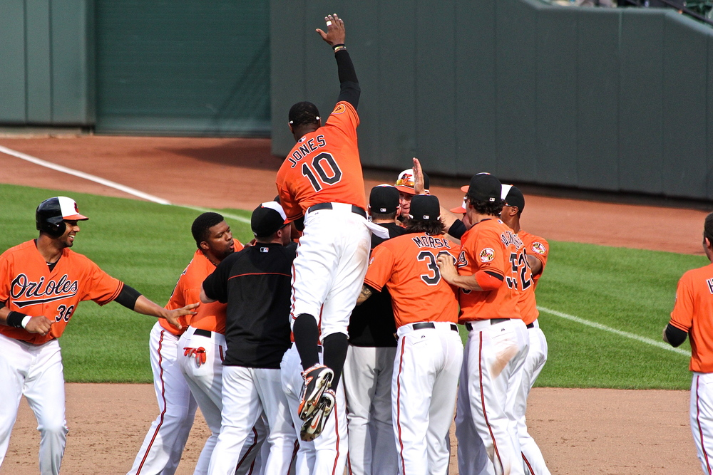 Adam Jones jumps on the pile