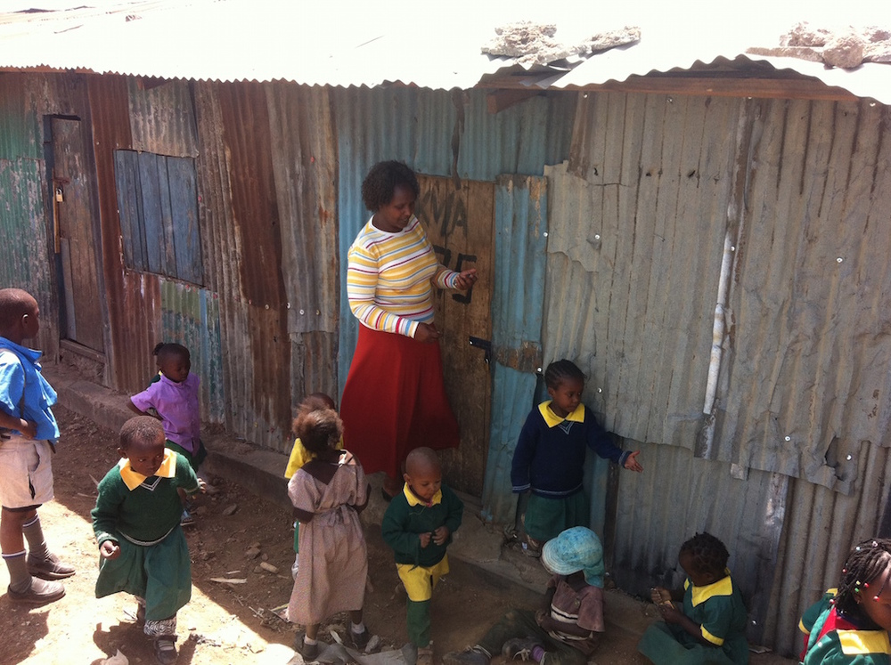Teacher Grace Kavoi with students.