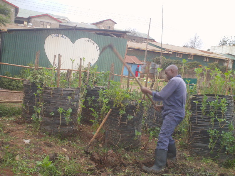 Headmaster Abel at work in the farm
