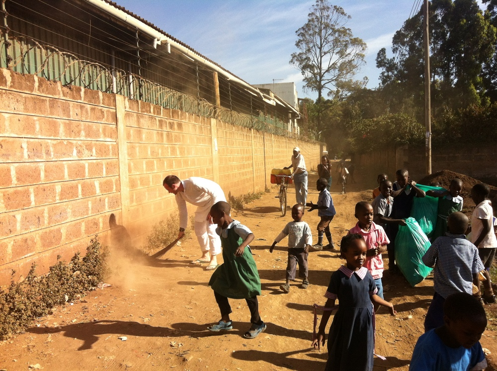 With students at the Brosis School in Nairobi during  a clean up effort.