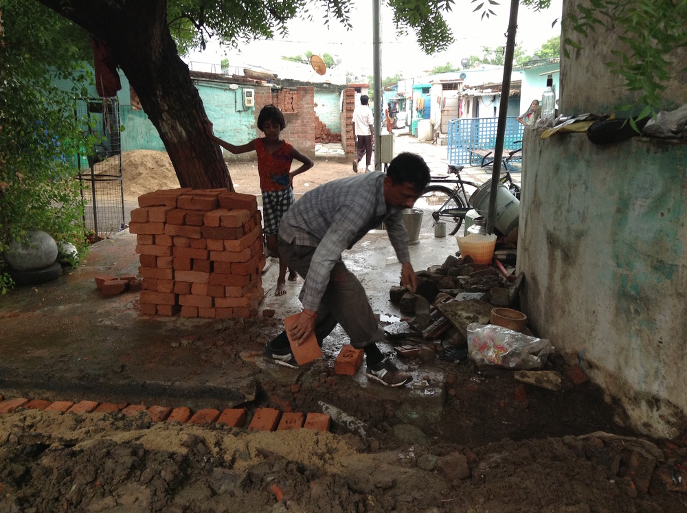 Bakhabhai, chief engineer, building the front wall.
