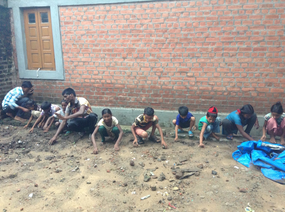 Kids combing for large stones and other debris.