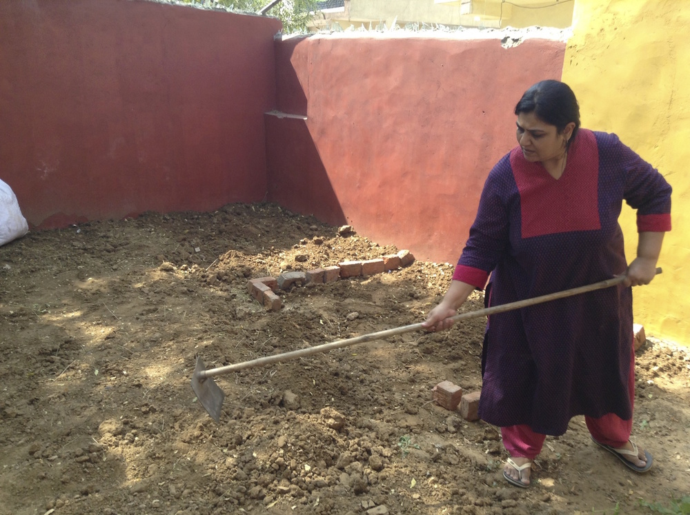 Purvi Vyas and team volunteer to help create the flower beds.