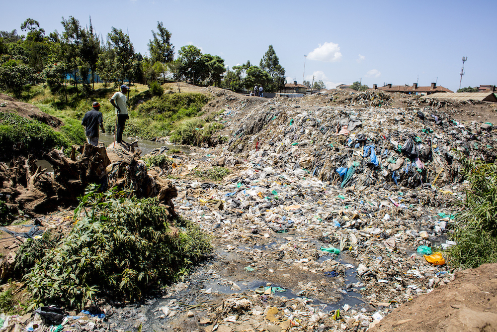 Waste piles up in the Kitui Ndogo slum, creating landfill-like conditions.