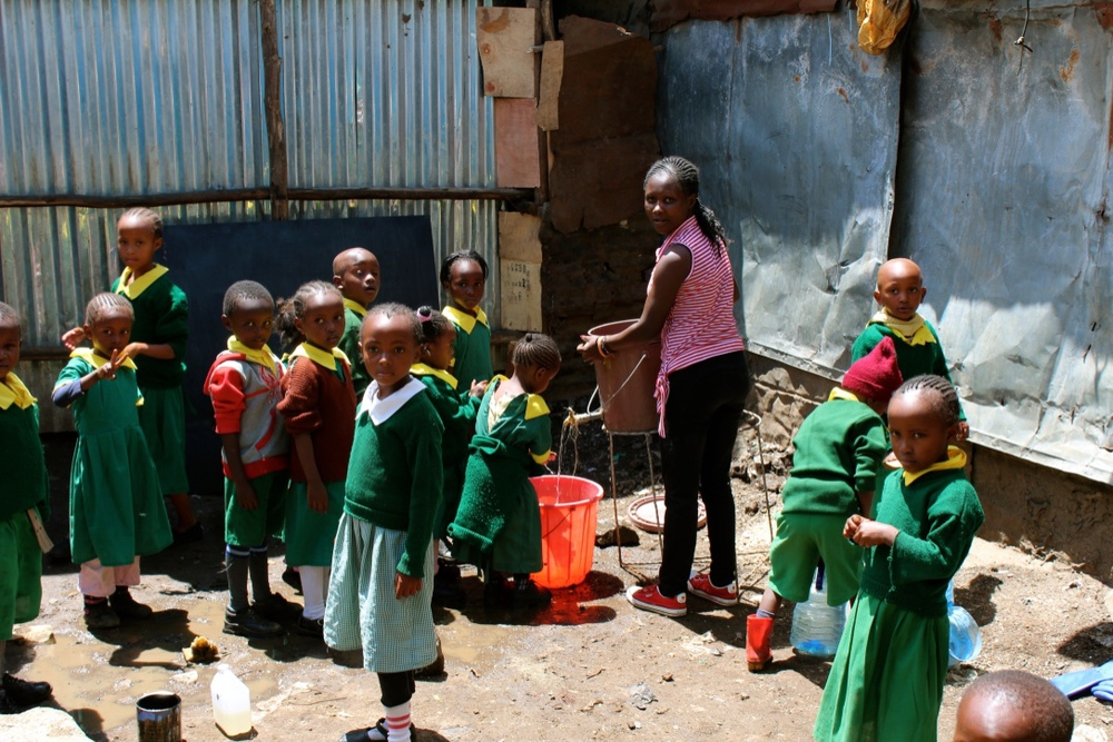 Students washing their hands.