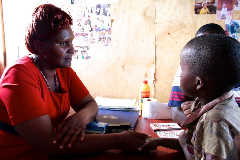 Teacher Grace counsels a student.