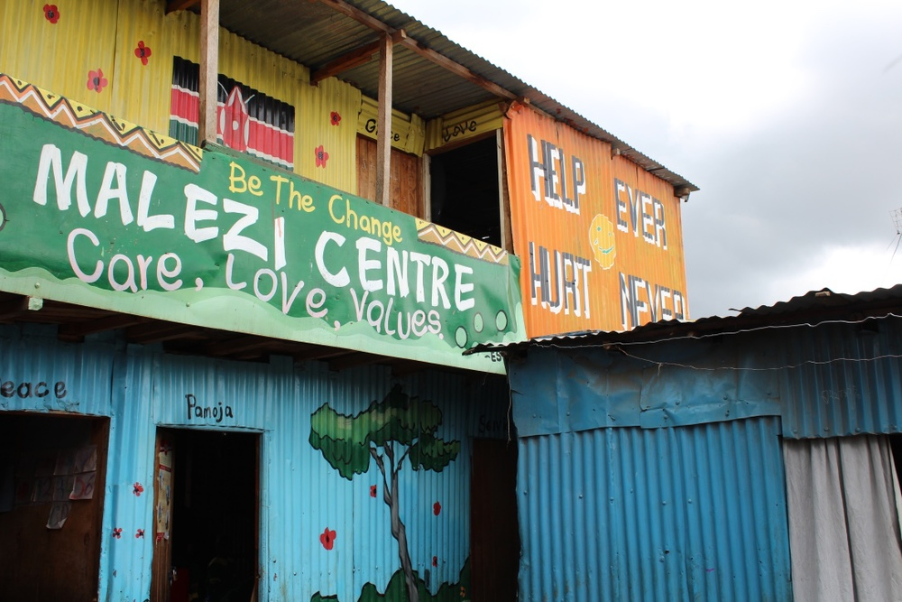 Front of Malezi with new 'Help Ever' mural.