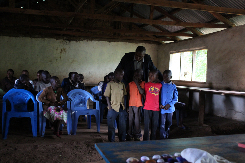 Assistant Area Chief, Joseph Gichana, talks to some of the younger orphans.