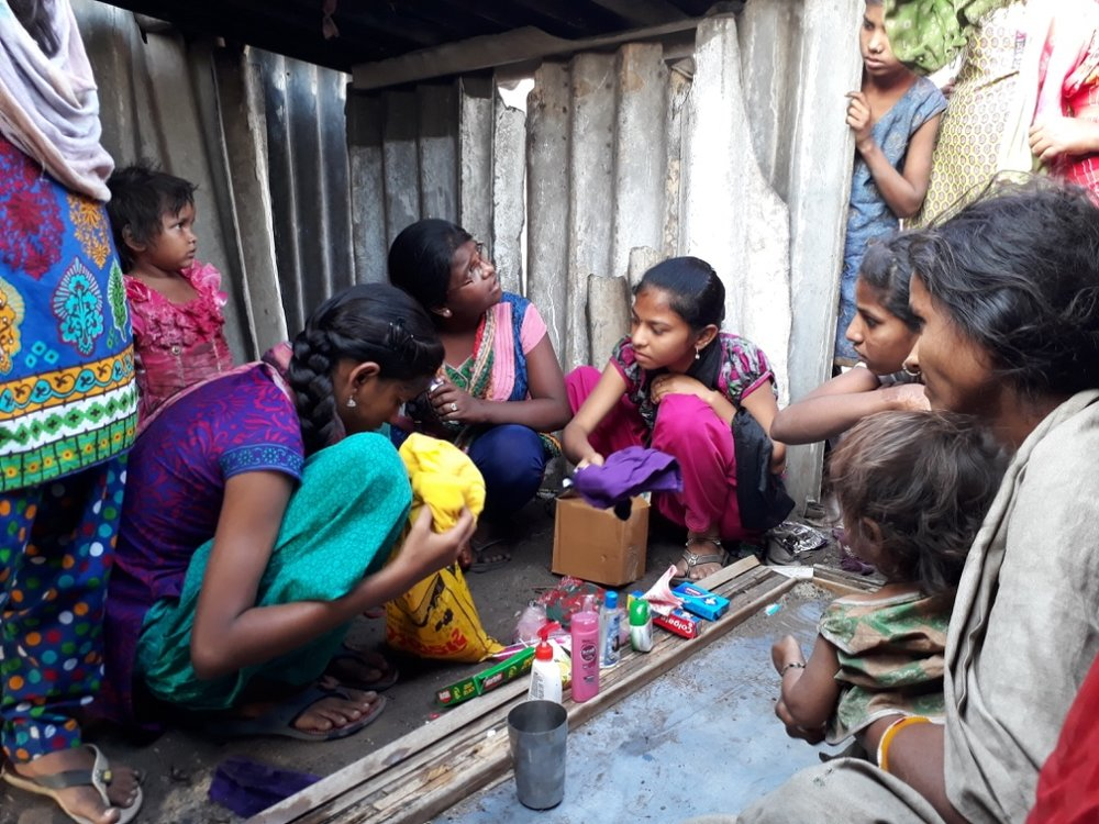 Dream Class delivering various goods to needy residents in a nearby slum community.