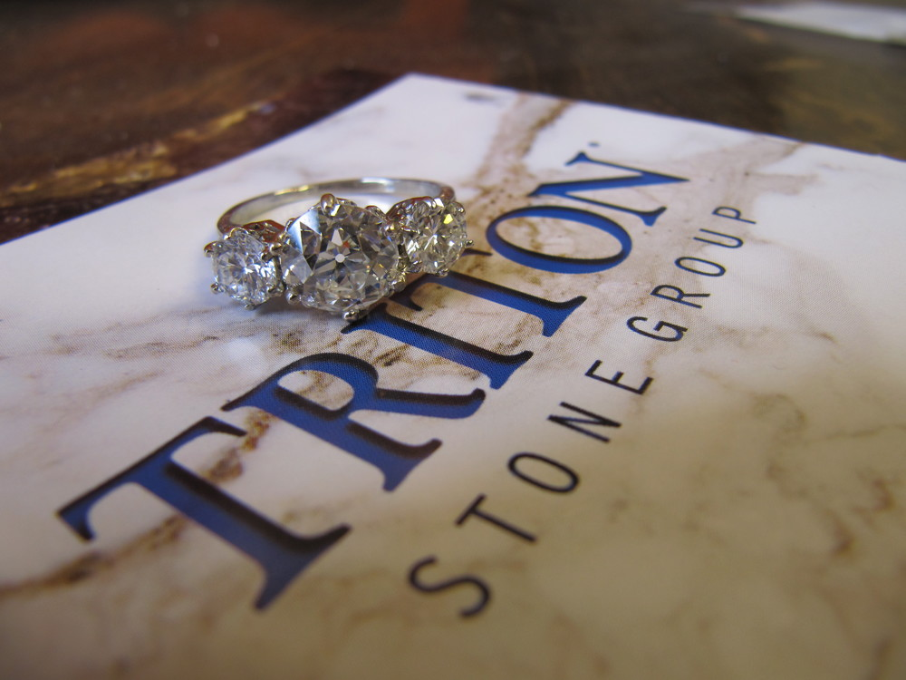3 stone diamond ring, 2.3 carat center diamond with a 1.16 carat diamond on either side set in 18K white gold, $23,500