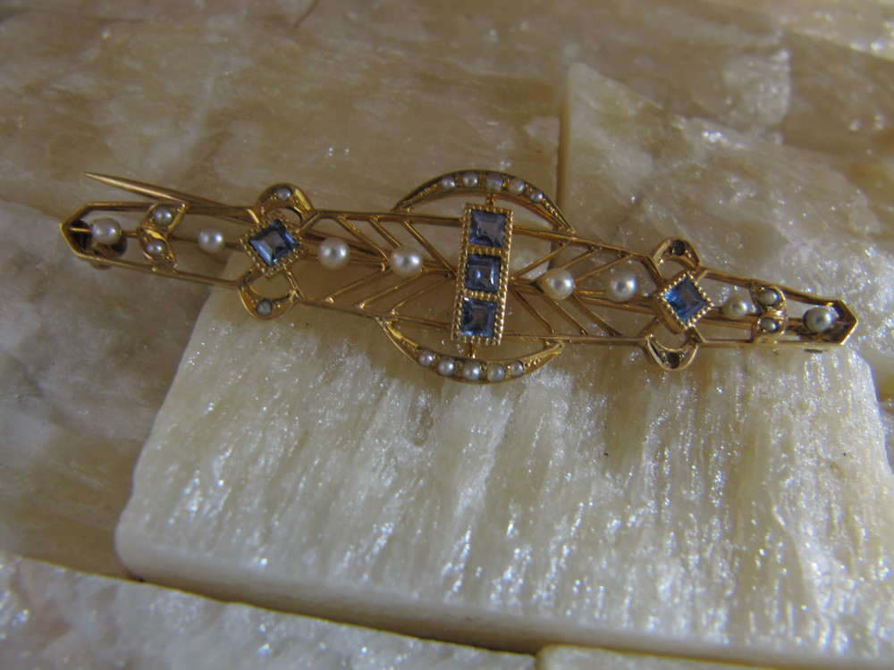 Yellow gold, seed pearl and sapphire pin