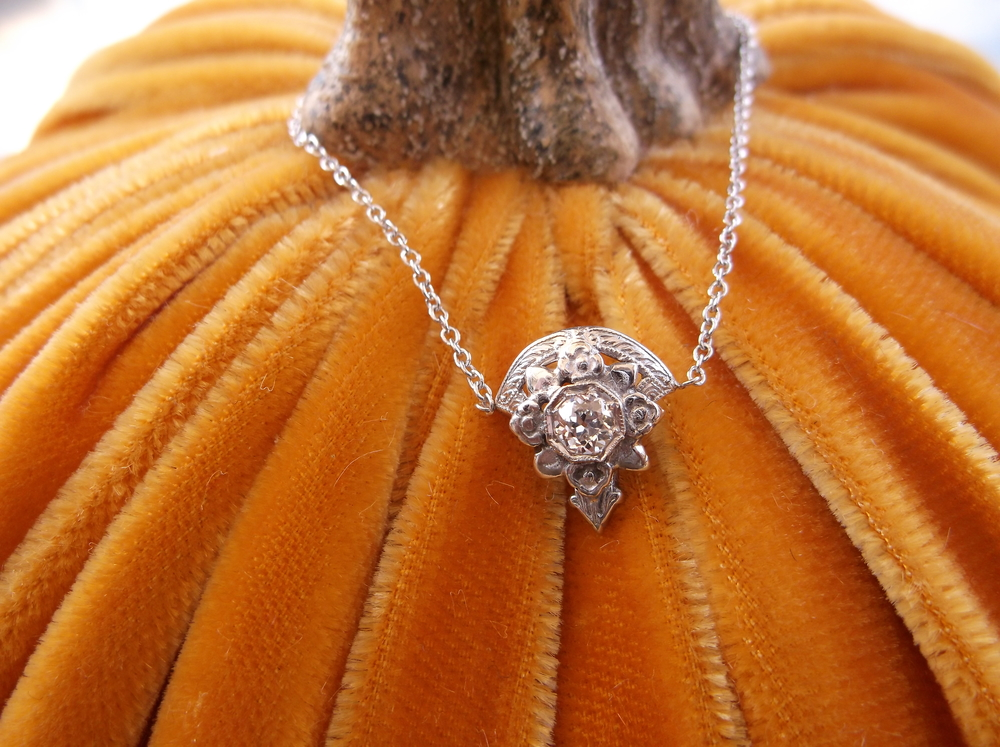 "!!!NEW CONTEST!!!    We are so close to reaching 2,000 ""likes""! Once we do, we will give away this gorgeous old mine cut diamond pendant! Simply ""like"" and share this photo and those likes/shares will be entered into the drawing! We cannot thank our fans enough for the kind words and support that we have received through our Facebook page!    So... share our page with friends and family and like this photo, and you could be the lucky winner!    (Chic velvet pumpkin courtesy of Avec Moi boutique in Downtown Franklin.)"