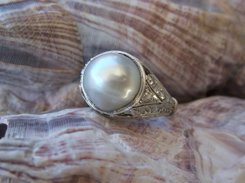 SOLD - Majestic 1920's pearl and diamond ring set in a gorgeous platinum mounting! 0.30 carats total weight in diamonds with a 10.5 mm pearl.