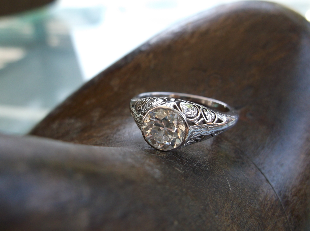 SOLD - Ravishing Art Deco 1.27 carat diamond ring set in a gorgeous white gold filigree bezel set mounting.
