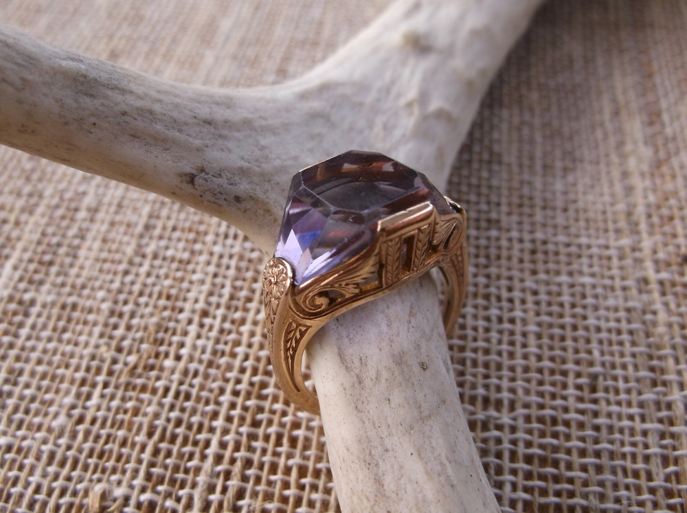 SOLD - Captivating Art Deco fancy cut amethyst set in a hand engraved gold mounting!