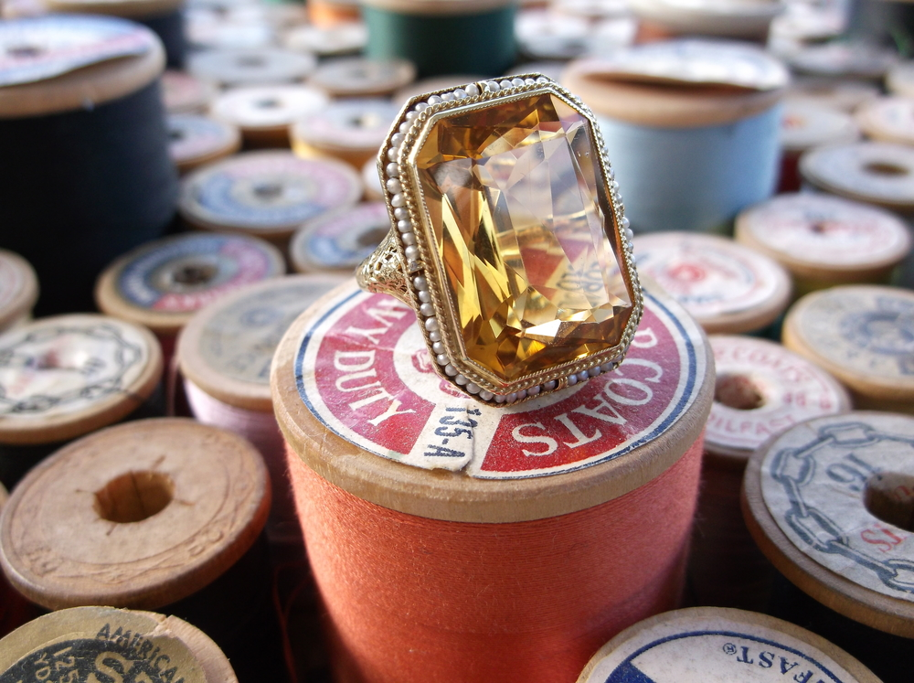 SOLD - Stunning citrine ring set in a beautifully detailed yellow gold mounting with surrounding seed pearls.
