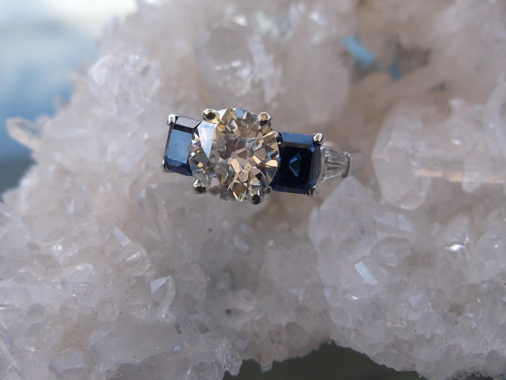 SOLD - Breathtaking 1.44 carat diamond set in a gorgeous platinum, sapphire and diamond mounting.
