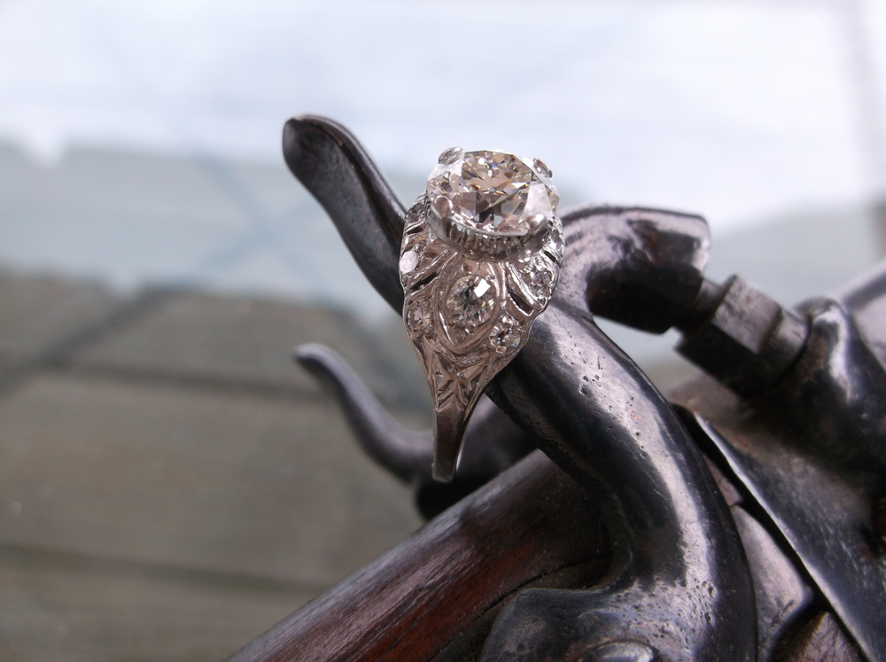 SOLD - Impressively elegant 1920's 2.10 carat Old European cut diamond and platinum ring with beautiful diamond detail. Someone needs to pull the trigger on this beauty!