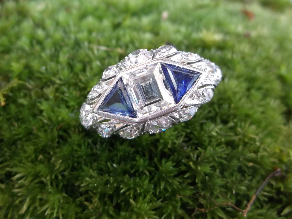 SOLD - Alluring Art Deco platinum, diamond and sapphire ring! Beautiful .70 carat asscher cut diamond in the center.