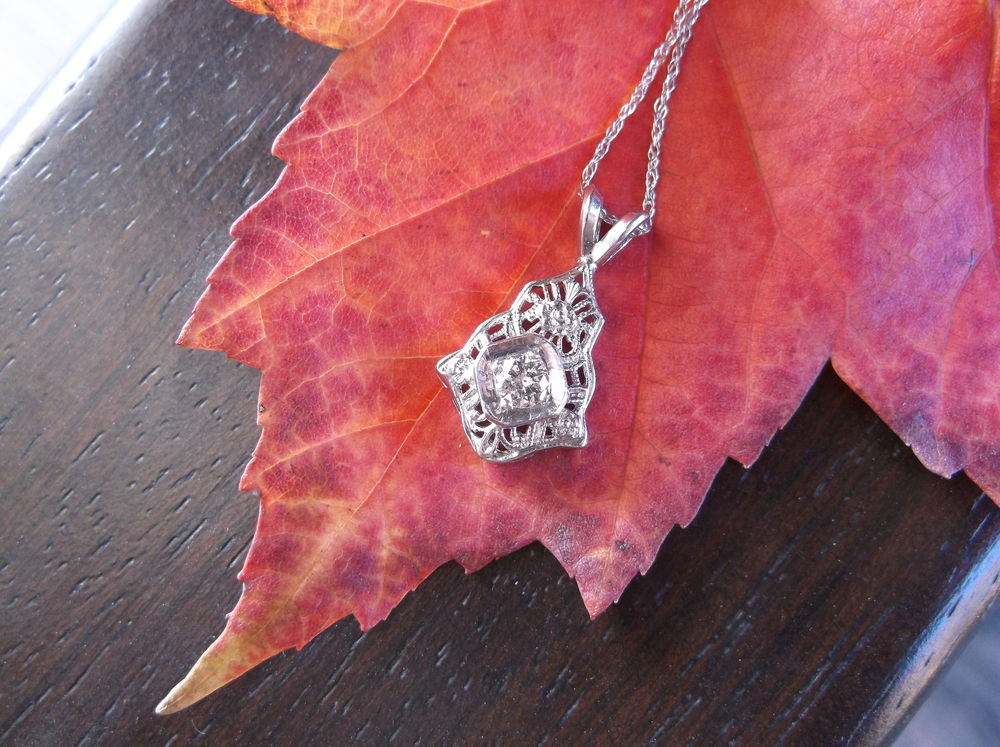 "!!!NEW CONTEST!!! This Thanksgiving, we are thankful for our fans! To say thanks for all your continued support, we have decided to give away this gorgous 1920's white gold filigree and diamond pendant! Simply ""like"" and ""share"" this photo and ""like"" our page and those ""likes/shares"" will be entered into the drawing!  We cannot thank our fans enough for the kind words and support that we continue to recieve through our Facebook page! So... share our page with friends and family and like this photo and this gorgeous necklace could be yours!"