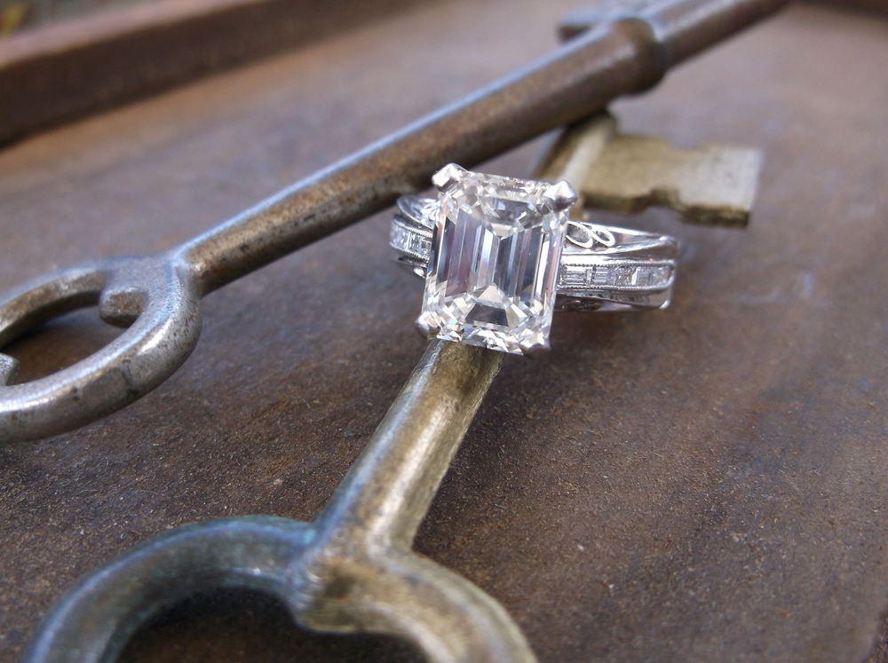 SOLD - Breathtaking 3.02 carat emerald cut diamond set in a beautiful diamond and platinum mounting!