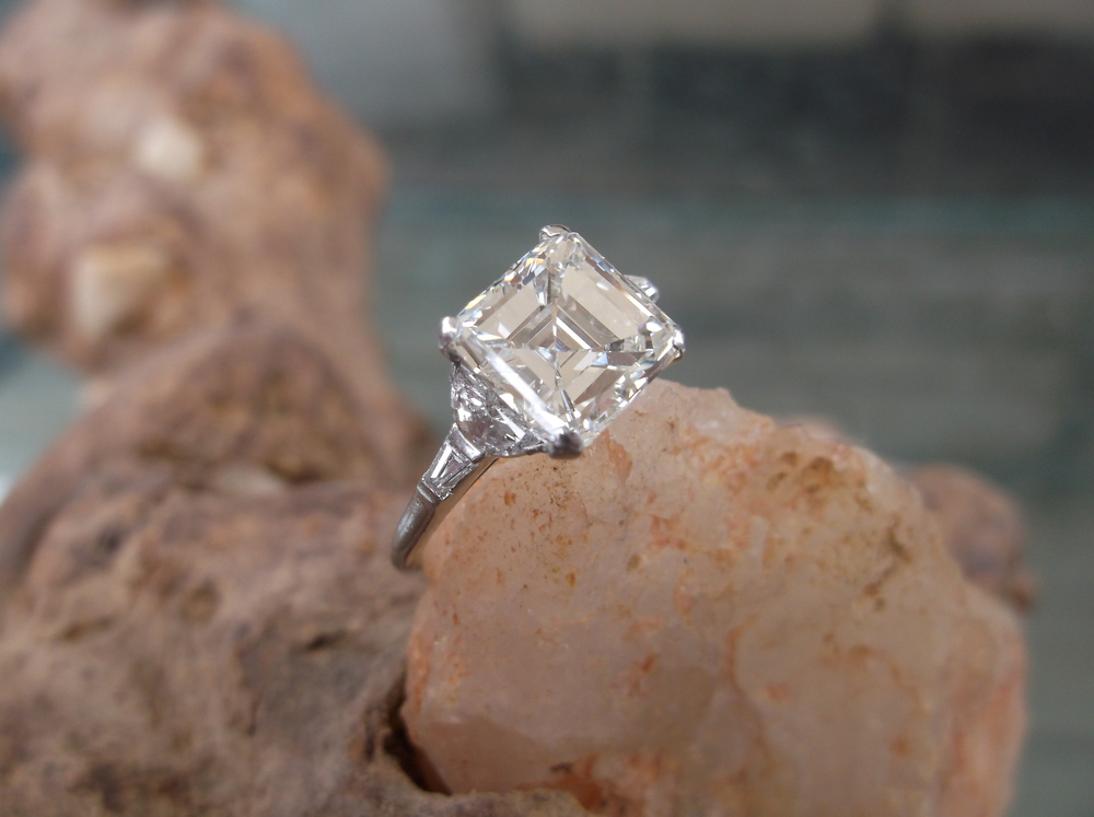 SOLD - Exquisite all original circa 1930, 2.60 carat asscher cut diamond set in platinum with stunning half moon and baguette diamonds on each side!