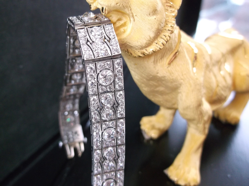 SOLD - Decadent all original 1920's diamond and platinum bracelet pictured in the jaws of a 22K gold tiger.
