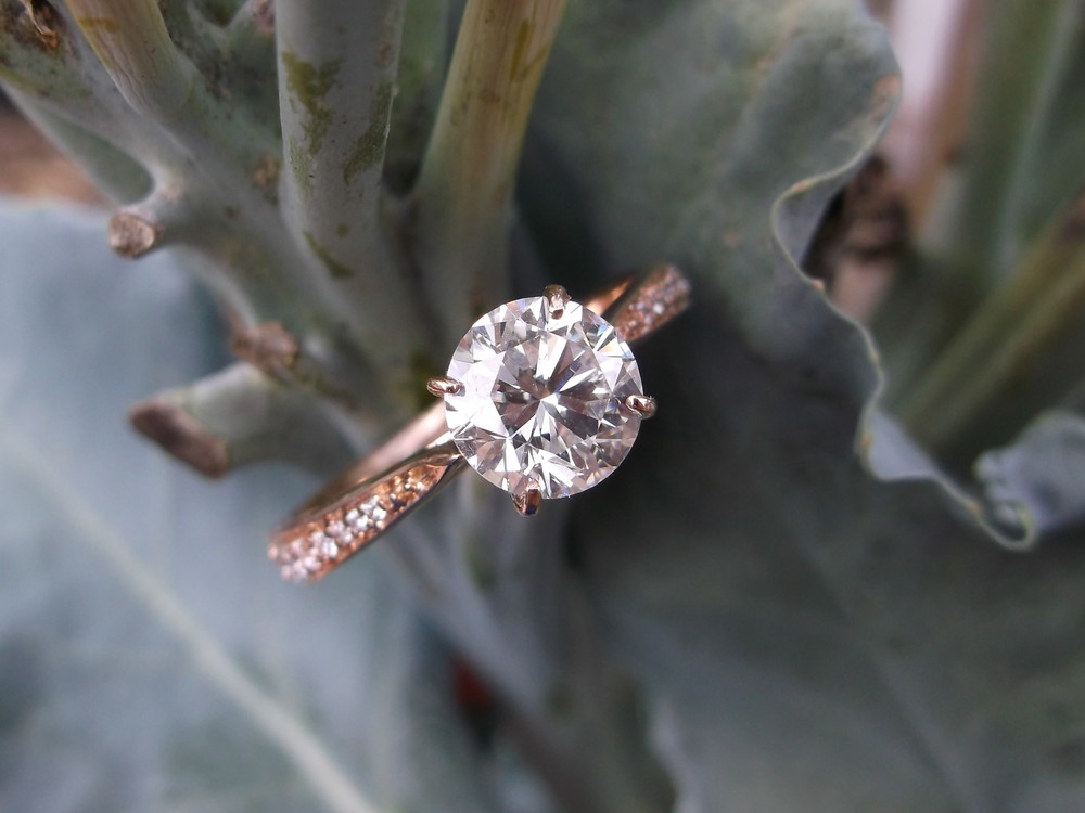SOLD - Lovely and dainty 1.04 carat diamond set in a diamond and rose gold mounting.