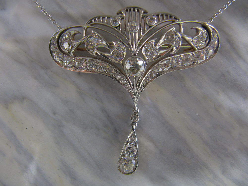 SOLD - Gorgeous Art Deco 4.5 carats total weight platinum on gold pendant that can also be worn as a pin.
