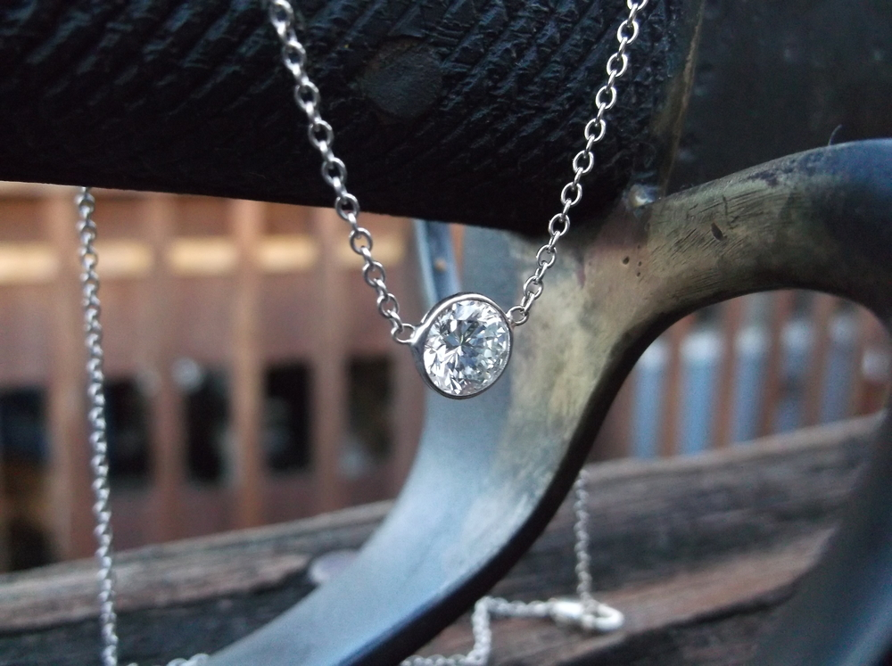 SOLD - Timeless elegance! 1.09 carat diamond necklace set in a white gold bezel and link chain.