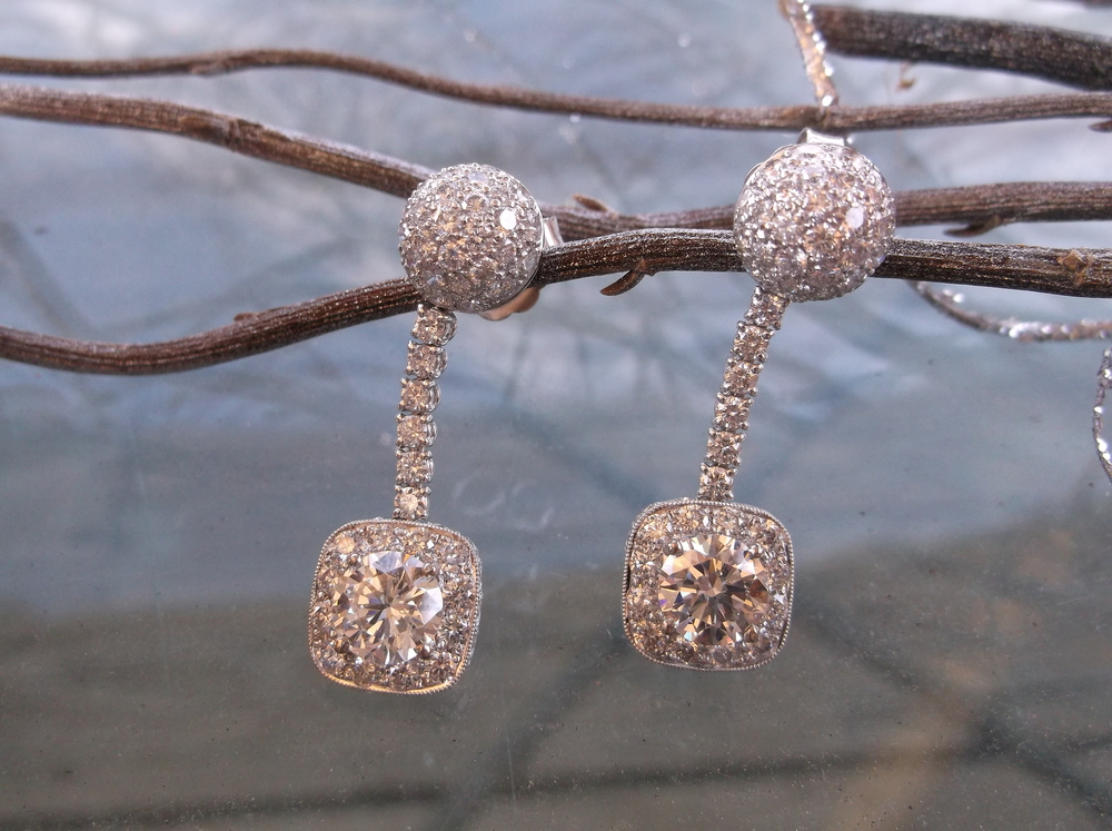 SOLD - Dazzling diamond earrings with 5.0 carats total weight in diamonds! The diamond dangling from each earring is 1.50 carats each!