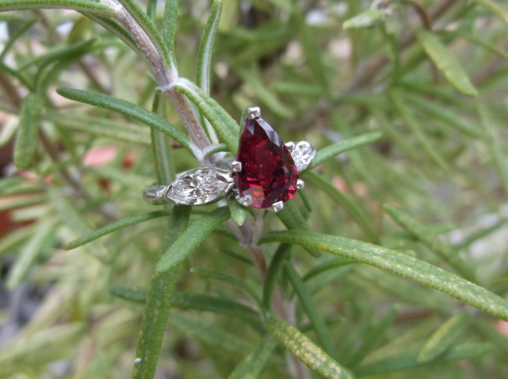 SOLD - Beautiful 1.72 carat pear shaped ruby set in a platinum mounting with a marquis diamond on either side!