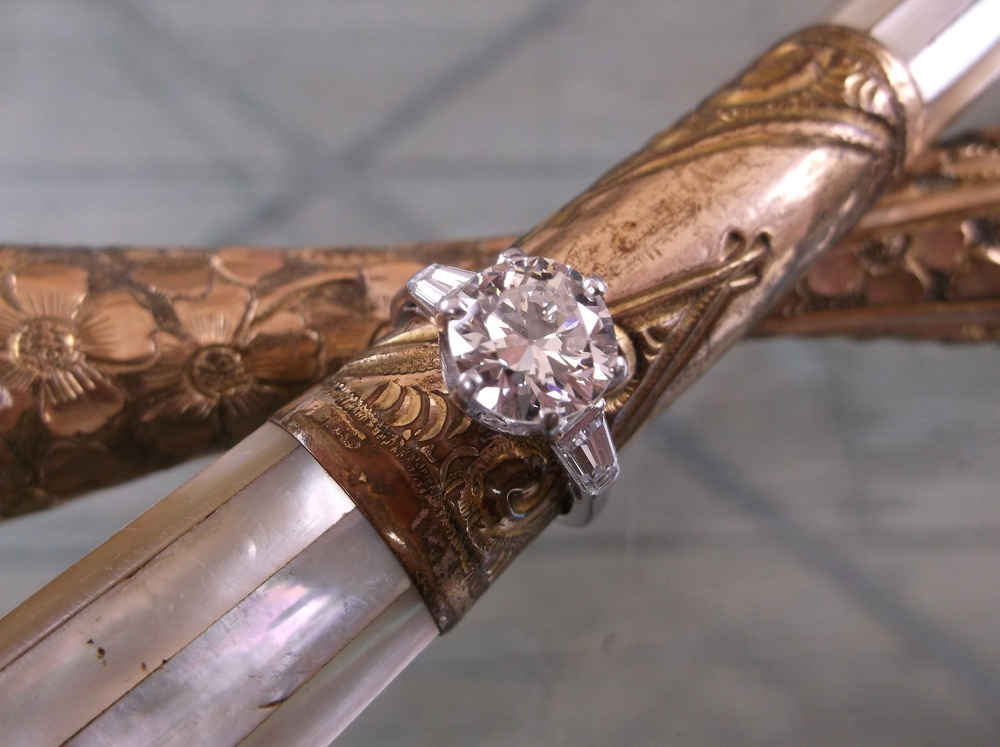 SOLD - Jaw dropping 2.70 carat diamond with a baguette diamond on each side set in a classic platinum mounting!