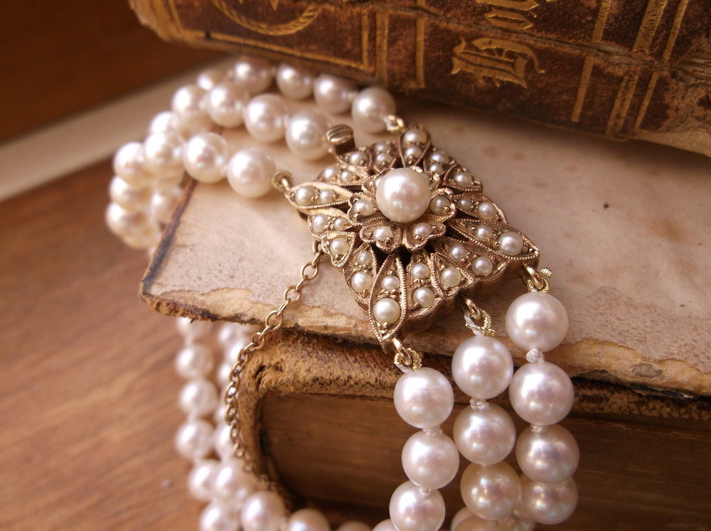 SOLD - Beautiful 1940's three strand pearl bracelet with a lovely yellow gold and pearl clasp.