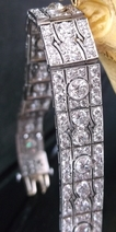 Sheryl's left wrist top: Art deco diamond and platinum bracelet.