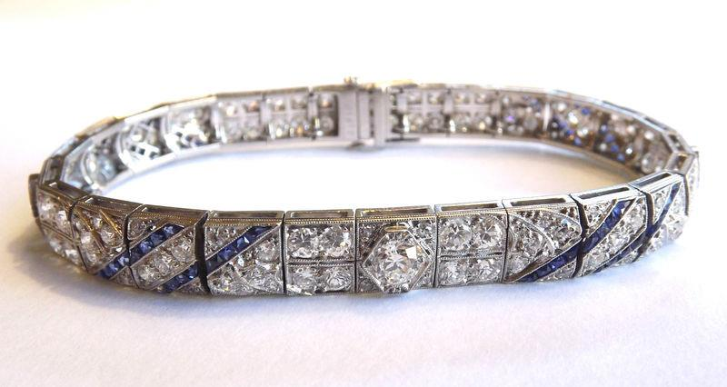 Sheryl's left wrist middle: Art Deco diamond and sapphire bracelet.