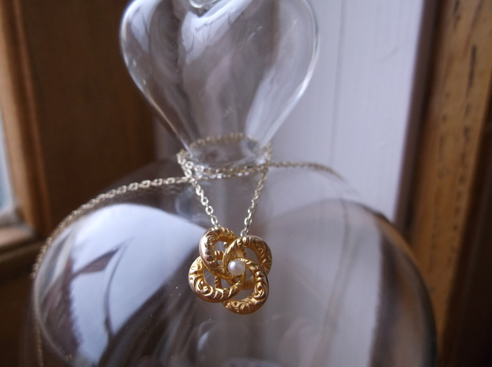 For February: Lovely Victorian era hand engraved gold and seed pearl love knot necklace.