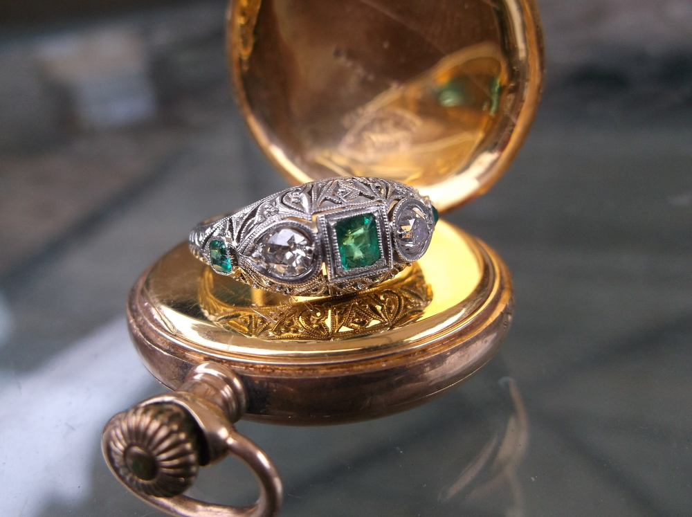 SOLD - Striking Art Deco emerald, diamond and filigree ring set in 18K white gold.