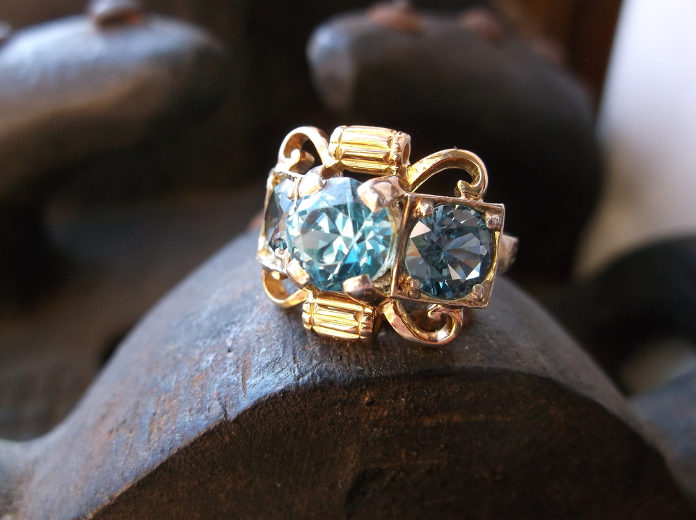 SOLD - Beautifully unique Retro 1940's blue zircon (center) and synthetic spinel (sides) ring set in 14K yellow gold.