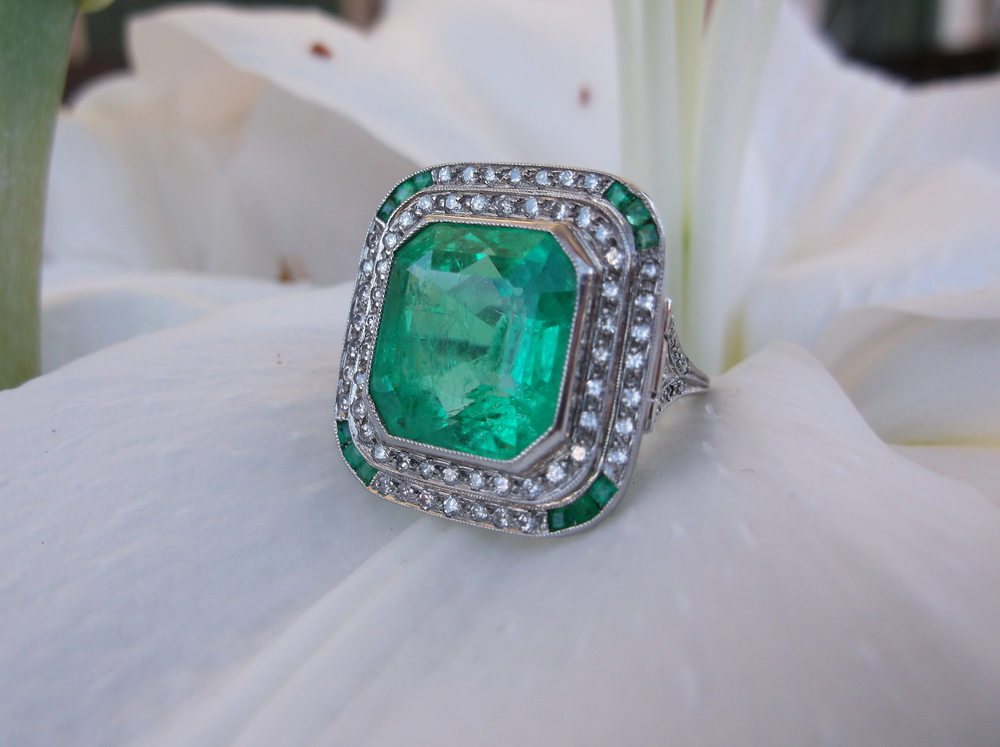 SOLD - Jaw dropping all original Art Deco 11.00 carat natural emerald ring with diamond and emerald detail set in platinum.