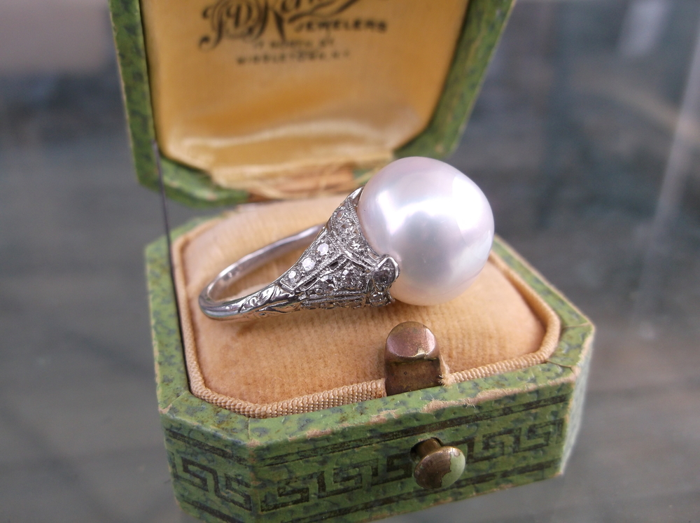SOLD - Art Deco inspired large south sea pearl set in a platinum mounting with beautiful diamond detail.