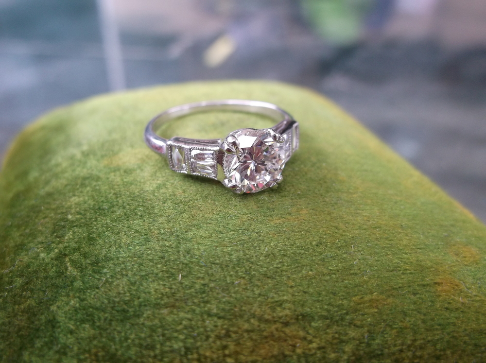 SOLD - 1930's 1.20 carat diamond ring with three superb swiss cut diamonds on each side.